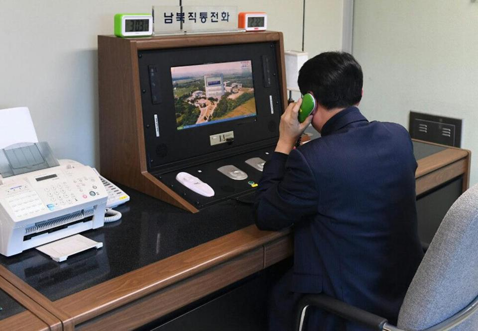 A South Korean government official checks the direct communications hotline to talk with the North Korean side at the border village of Panmunjom in Paju, South Korea, Wednesday.