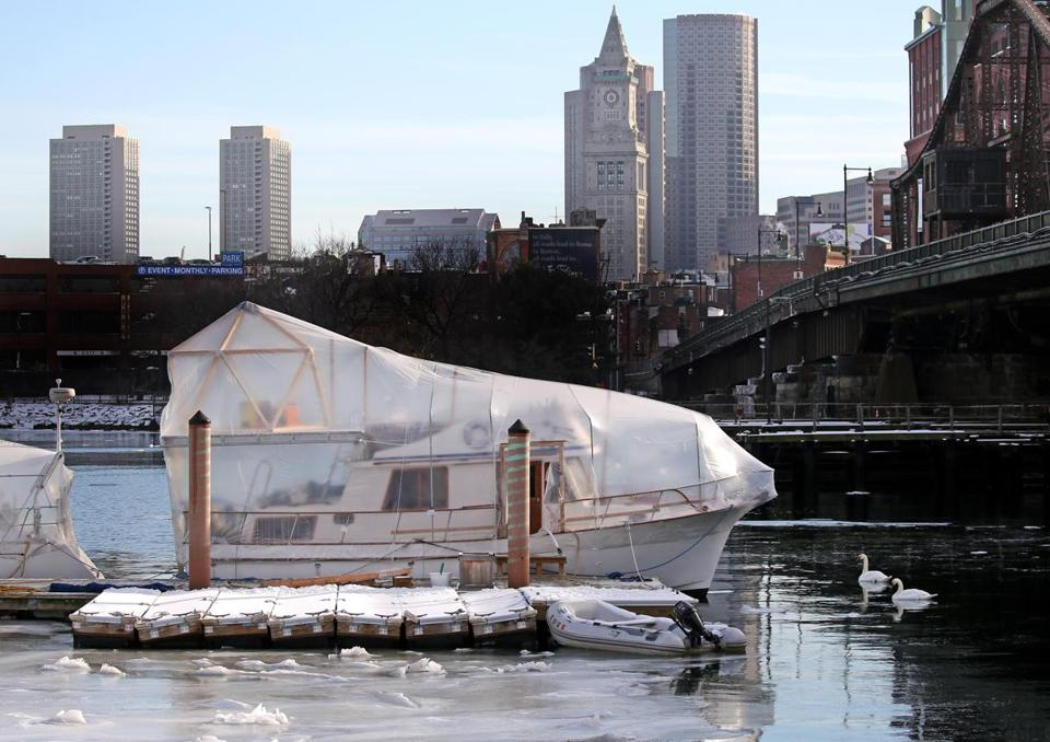 A boat in shrinkwrap at Constitution Marina Charlestown on Wednesday.