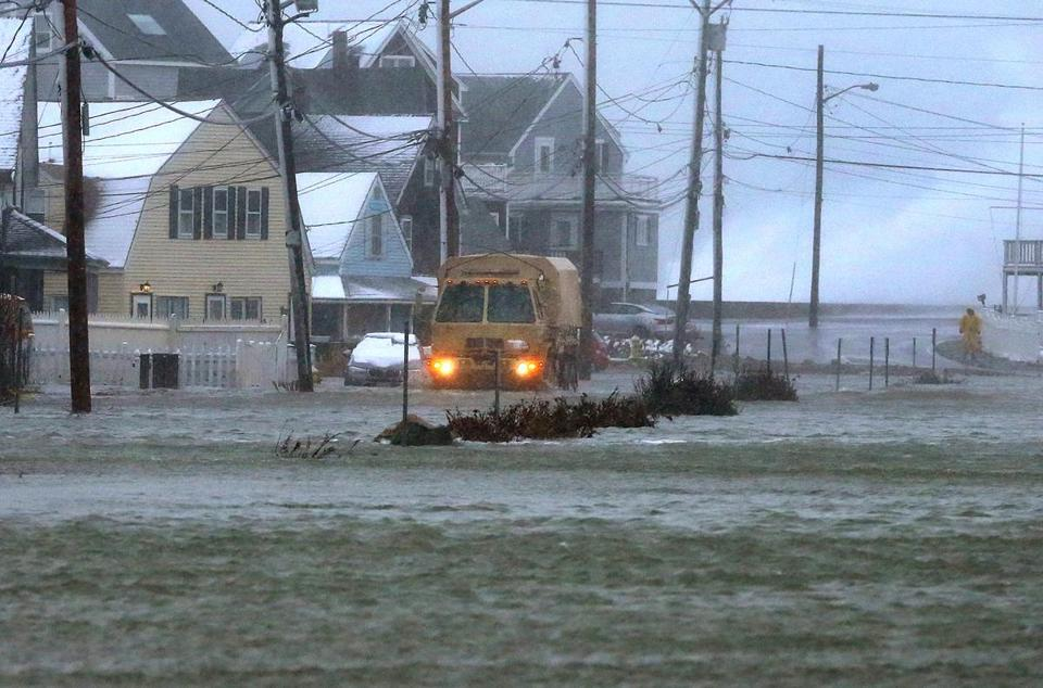 A rescue vehicle helped remove residents in Marshfield.