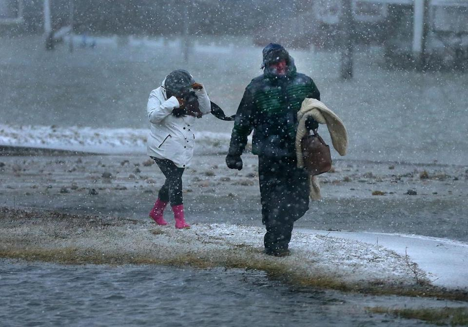 Two residents who did not want to spend the night in their home in the flooded Brant Rock section of Marshfield walked through the streets.