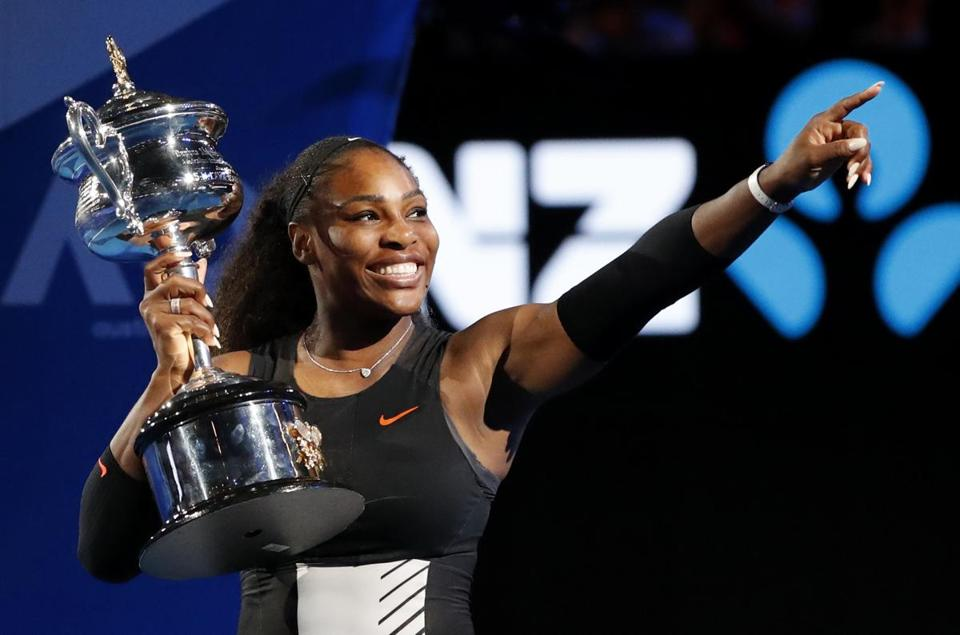 FILE - In this Jan. 28, 2017 file photo, United States' Serena Williams gestures as she holds her trophy after defeating her sister Venus in the women's singles final at the Australian Open tennis championships in Melbourne, Australia. Williams, defending champion has withdrawn from the 2018 Australian Open, saying she is not ready to return to tournament tennis.(AP Photo/Dita Alangkara, File)