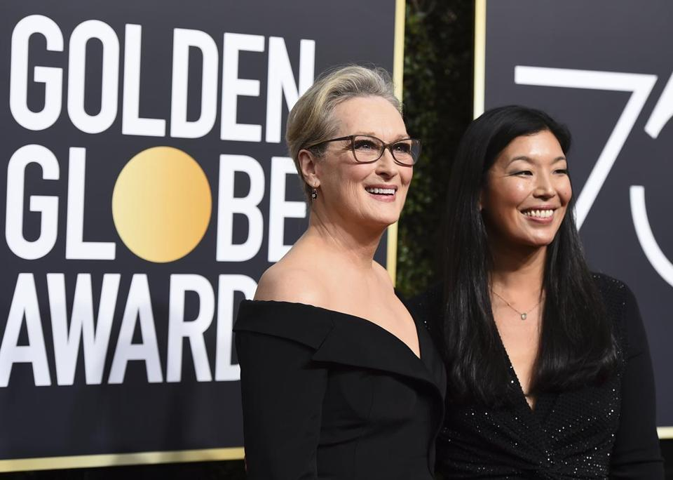 Meryl Streep, left, and Ai-jen Poo arrive at the 75th annual Golden Globe Awards at the Beverly Hilton Hotel on Sunday, Jan. 7, 2018, in Beverly Hills, Calif. (Photo by Jordan Strauss/Invision/AP)