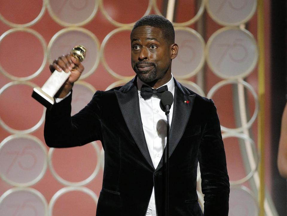 "TSterling K. Brown accepting the award for best actor in a TV drama series for his role in ""This Is Us."""