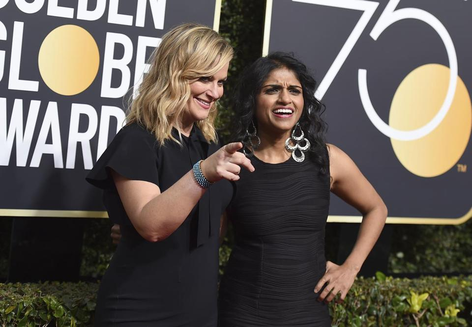Amy Poehler, left, and Saru Jayaraman arrive at the 75th annual Golden Globe Awards at the Beverly Hilton Hotel on Sunday, Jan. 7, 2018, in Beverly Hills, Calif. (Photo by Jordan Strauss/Invision/AP)