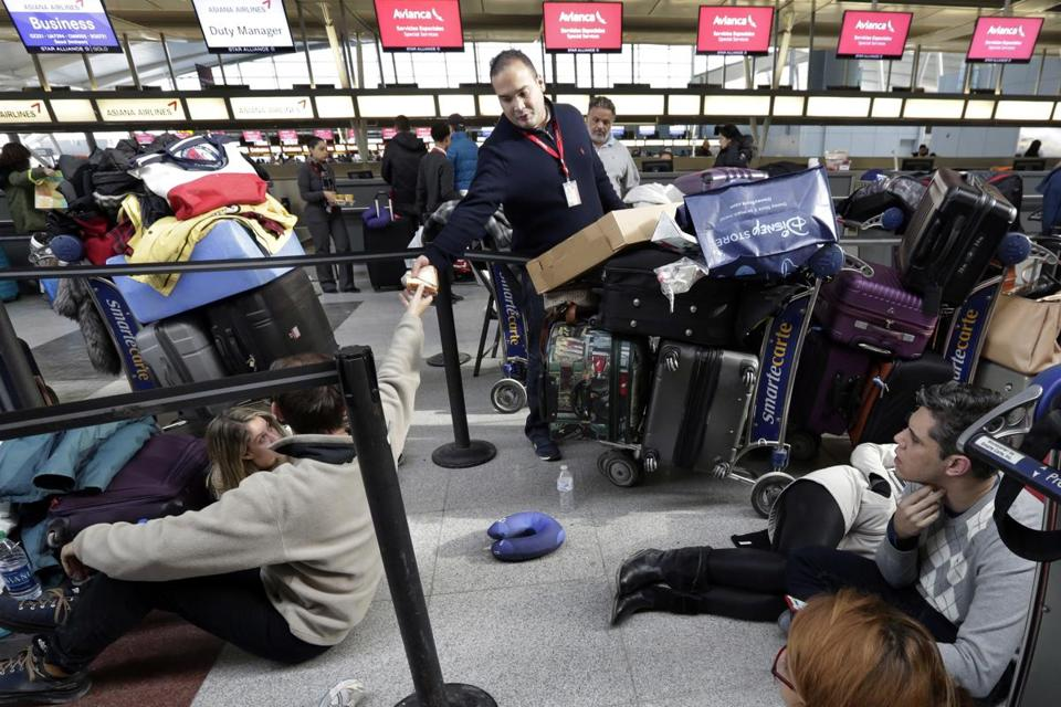 Flooding at JFK terminal adds to delays from winter weather