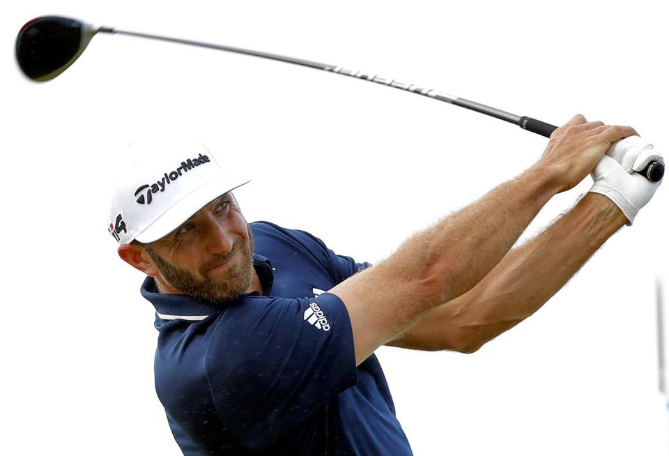 Dustin Johnson plays his shot from the 10th tee during the final round of the Tournament of Champions golf event, Sunday, Jan. 7, 2018, at Kapalua Plantation Course in Kapalua, Hawaii. (AP Photo/Matt York)