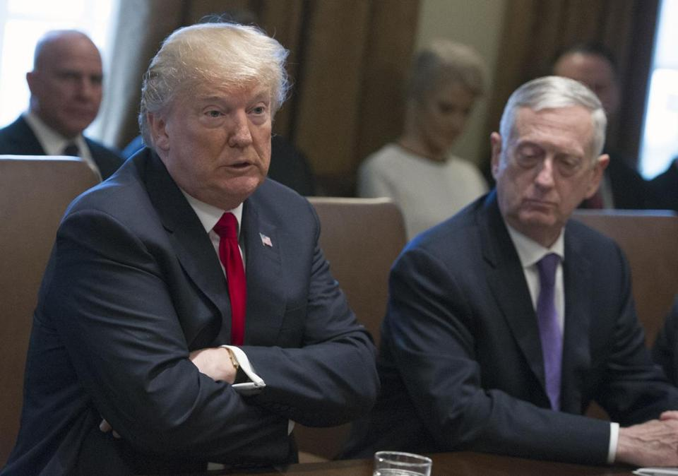 Mandatory Credit: Photo by Ron Sachs/POOL/EPA-EFE/REX/Shutterstock (9314104a) Donald J. Trump and Jim Mattis Trump Cabinet Meeting, Washington, USA - 10 Jan 2018 US President Donald J. Trump makes opening remarks as he holds a Cabinet meeting in the Cabinet Room of the White House in Washington, DC, USA, 10 January 2018. Looking on from right is US Secretary of Defense Jim Mattis.