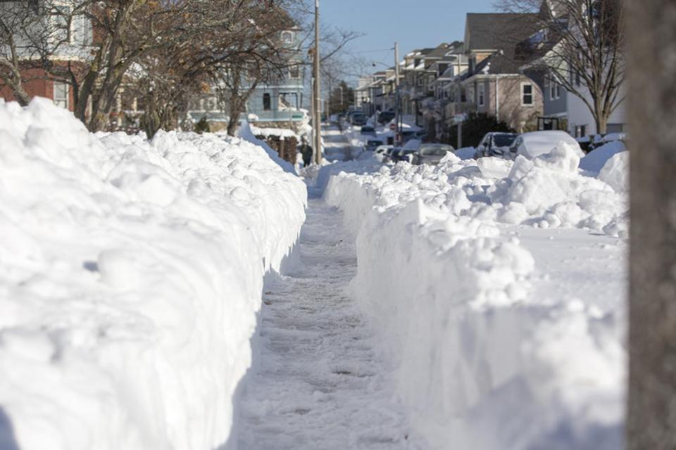 "BOSTON, MA - JANUARY 05: A shoveled sidewalk is seen the day after the region was hit with a ""bomb cyclone"" on January 5, 2018 in the Dorchester neighborhood of Boston, Massachusetts. Schools and businesses throughout the Boston area get back to work today after the city received over a foot of snow during the fast moving storm yesterday. (Photo by Scott Eisen/Getty Images)"
