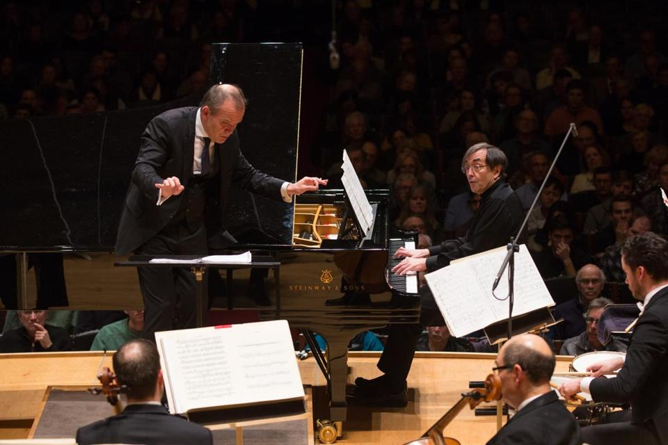 Francois-Xavier Roth conducts pianist Pierre-Laurent Aimard and the BSO during Bartok's Piano Concerto No. 1 at Symphony Hall Thursday night.