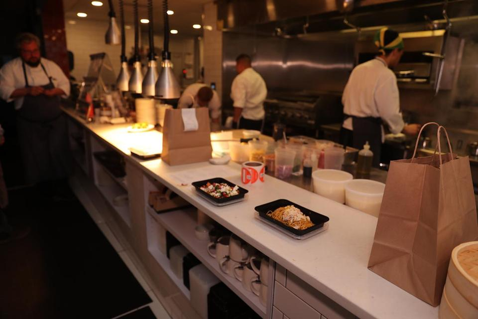 A take-out meal awaits delivery service on the counter at Bar Mezzana.