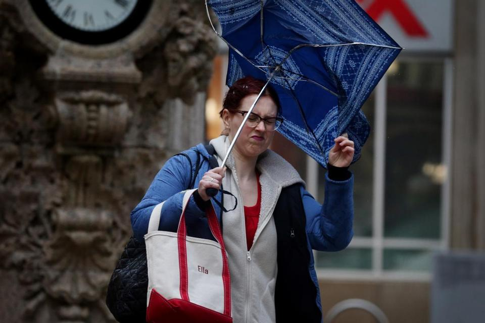 Boston, MA- January 12, 2018: Ella Bessmer battles with her umbrella while walking on Washington Street in Boston, MA on January 12, 2018. After last week's winter storm that deluged coastal areas and blasted snow across New England, followed by a regional thaw, Massachusetts residents are preparing for rains Friday and Saturday that are expected to rapidly melt more snow and cause further flooding before a cold front arrives to refreeze everything. (Globe staff photo / Craig F. Walker) section: metro reporter: