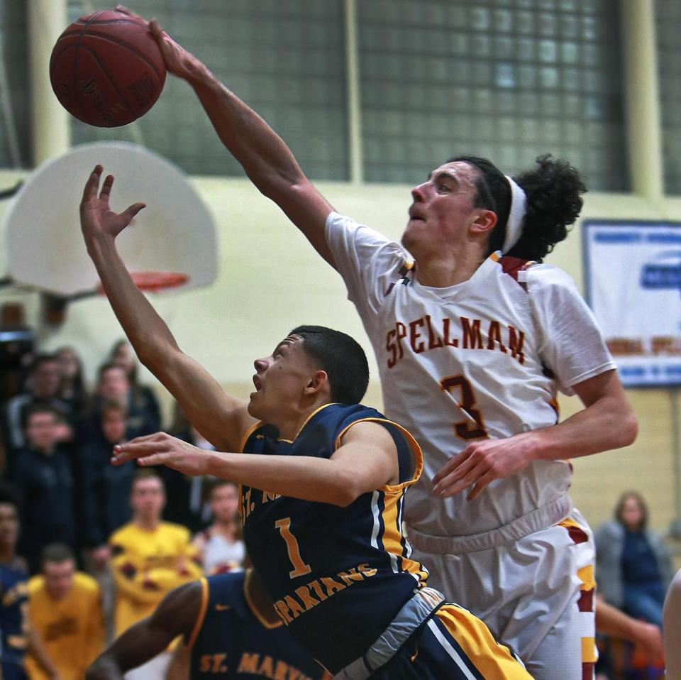 Brockton, MA 1-11-18: Cardinal Spellman's Craig Faria (3,right) comes from behind to block a first quarter shot attempt by St. Mary's Jalen Echevarria (1,left). St. Mary's of Lynn visited Cardinal Spellman in a boy's high school basketball game. (Jim Davis/Globe Staff)