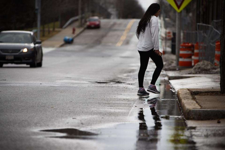 Puddles lined a road in Somerville Saturday — before temperatures rapidly dropped, raising fears of black ice.