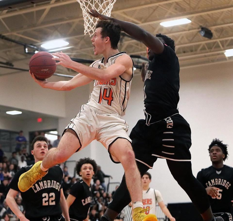 Newton, MA - 1/12/2018 - Newton North's Ethan Wright (14) goes up and under CR&L Jonathan Cenescar (11) for a reverse layup. Cambridge R&L boys' basketball at host Newton North. - (Barry Chin/Globe Staff), Section: Sports, Reporter: Nathaniel Weitzer, Topic: 13schrdp, LOID:8.4.625604440.