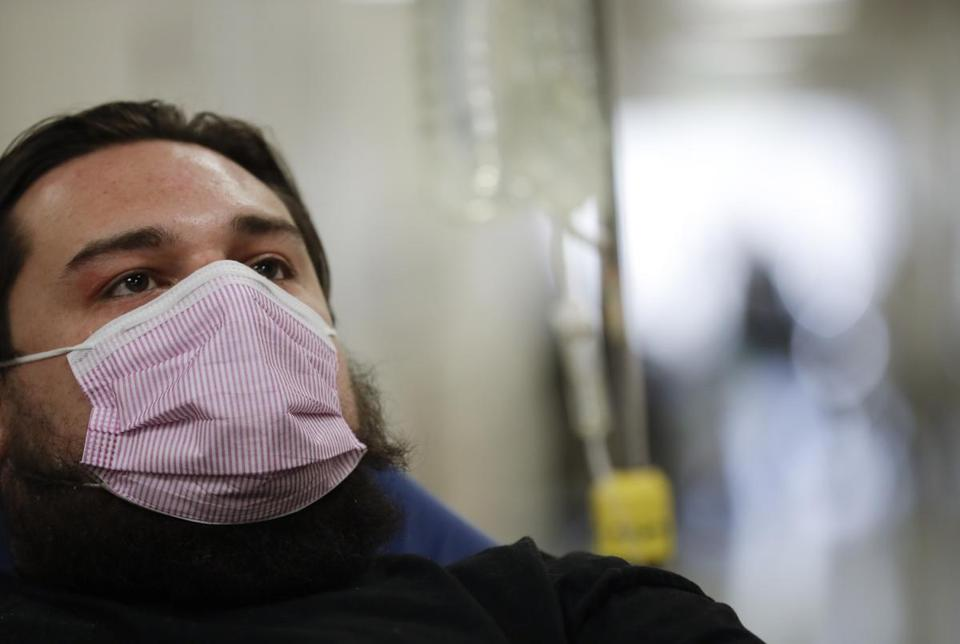 Donnie Cardenas was recovering from the flu at the Palomar Medical Center in Escondido, Calif., last week. The San Diego County resident said he was battling a heavy cough for days before a spike his temperature sent him into the emergency room.