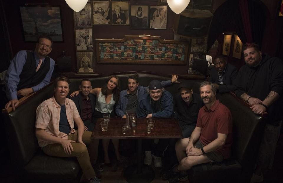 Crashing regularly casts standup comedians as guest stars. From left: performers Penn Jillette, Pete Holmes, Gilbert Gottfried, Rachel Feinstein, Dan Naturman, Artie Lange, Dave Attell, Judd Apatow, Keith Robinson, and Jay Oakerson on the set of the season 2 premiere.