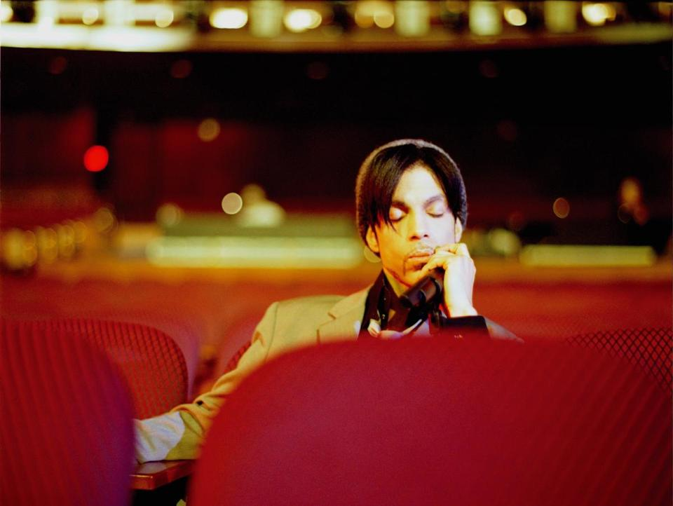 "Prince relaxing after a soundcheck in Hollywood, from ""Prince: A Private View."""
