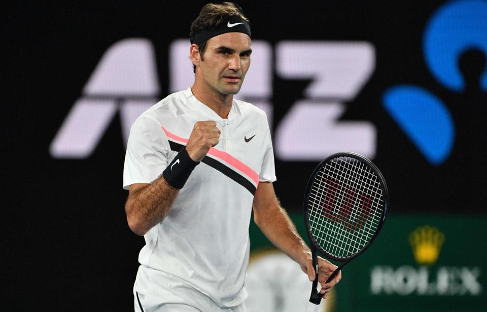 Switzerland's Roger Federer reacts after beating Germany's Jan-Lennard Struff in their men's singles second round match on day four of the Australian Open tennis tournament in Melbourne on January 18, 2018. / AFP PHOTO / SAEED KHAN / -- IMAGE RESTRICTED TO EDITORIAL USE - STRICTLY NO COMMERCIAL USE --SAEED KHAN/AFP/Getty Images