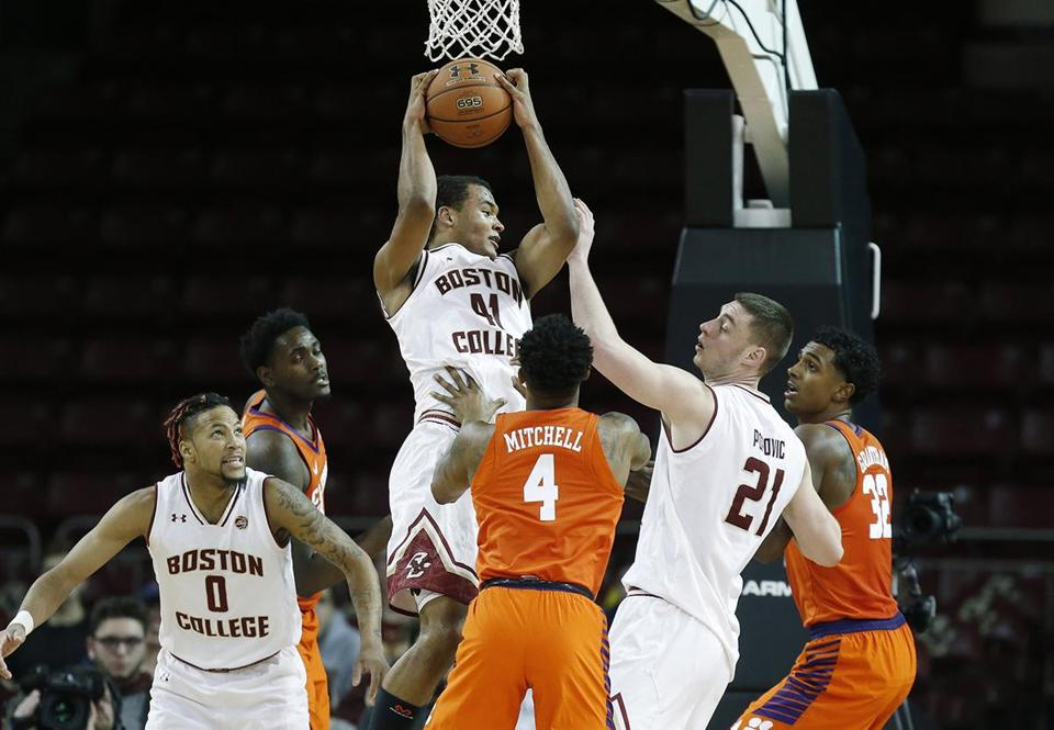 Boston College's Steffon Mitchell (41) grabs a rebound in front of Clemson's Shelton Mitchell (4) during the second half of an NCAA college basketball game in Boston, Wednesday, Jan. 3, 2018. Clemson won 74-70. (AP Photo/Michael Dwyer)