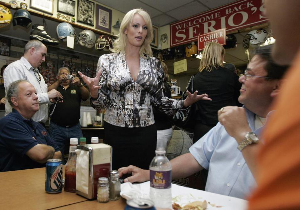 File- This May 6, 2009, shows Stormy Daniels visiting a local restaurant in downtown New Orleans. A tabloid magazine held back from publishing Daniels 2011 account of an alleged affair with Donald Trump after the future president's personal lawyer threatened to sue, four former employees of the tabloid's publisher told The Associated Press. (AP Photo/Bill Haber, File)