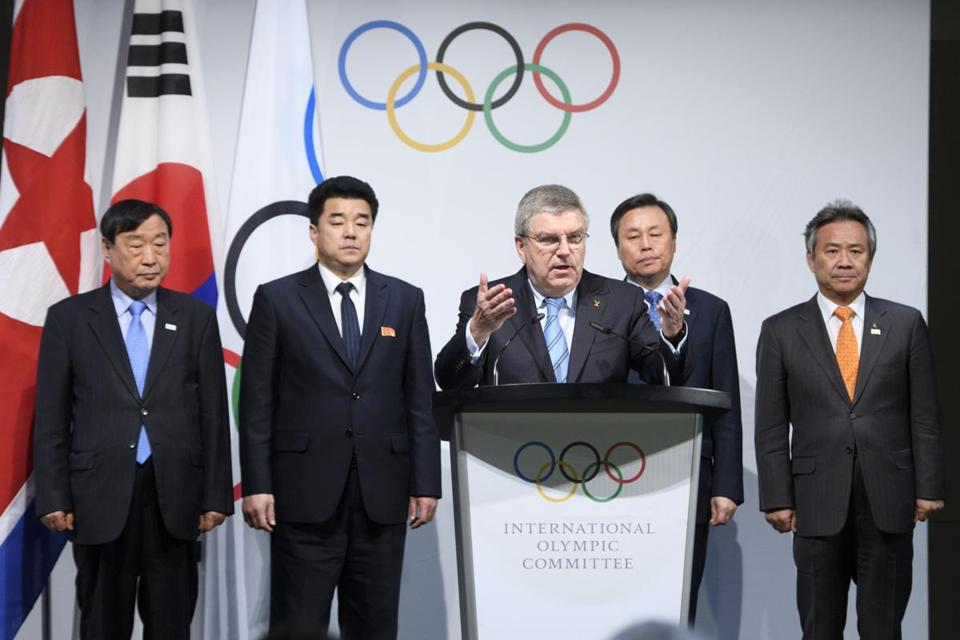 Mandatory Credit: Photo by LAURENT GILLIERON/EPA-EFE/REX/Shutterstock (9327017ba) Kim Il Guk, Thomas Bach and Do Jong-hwan North and South Korean Olympic Participation Meeting in Pully, Switzerland - 20 Jan 2018 International Olympic Committee (IOC) president Thomas Bach (C) speaks in front of from (L-R) Lee Hee-beom, president of the PyeongChang Organizing Committee for the 2018 Olympic and Paralympic Winter Games (POCOG), North Korea's Olympic Committee President and sports minister Kim Il Guk, left, South Korea's Sports Minister Do Jong-hwan and South Korea's President of the National Olympic Committee (NOC) Lee Kee-heung during a press briefing and before a signing ceremony after the North and South Korean Olympic Participation Meeting at the Olympic Museum of the International Olympic Committee (IOC) in Lausanne, Switzerland, 20 January 2018. The meeting produced an agreement that 22 athletes from North Korea will participate in the Olympic event, and they will march with athletes from South Korea under one flag during the ceremony. North Korean athletes are to compete in three sports and five disciplines.