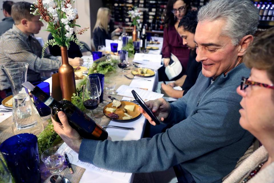 Chuck Tortorello, of Medway, took a picture of a bottle of 2015 Duca di Cardino Rosso di Montepulciano during a wine class at VINOvations in Sharon recently.