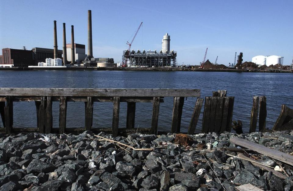 Everett officials say the Mystic Generating Station is a much more valuable property after the plant's owners spent more than originally planned on its upgrade.