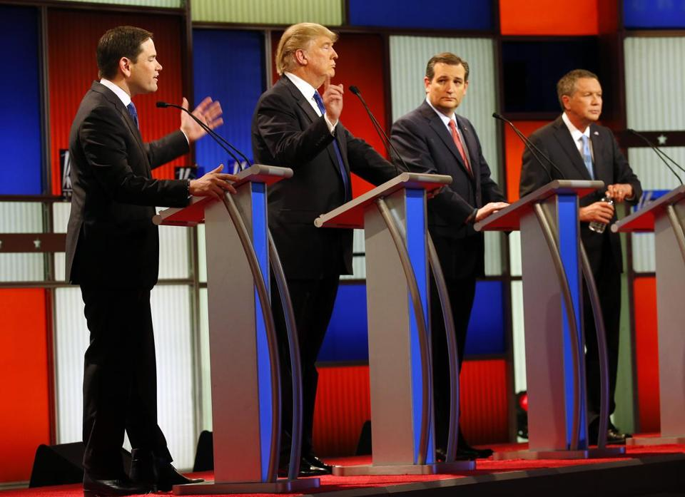 Republican presidential candidates, Sen. Marco Rubio, R-Fla., and businessman Donald Trump argue as Sen. Ted Cruz, R-Texas, and Ohio Gov. John Kasich listen during a Republican presidential primary debate at Fox Theatre, Thursday, March 3, 2016, in Detroit. (AP Photo/Paul Sancya)