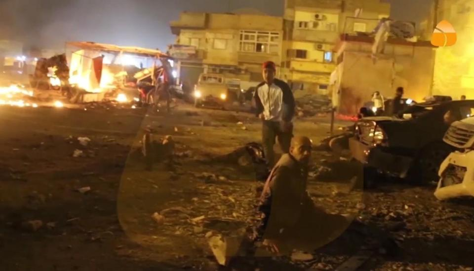 This grab taken from Al Hadath Channel video on Tuesday Jan. 23 2018 shows debris at the site of an explosion in Benghazi Libya. Two consecutive car bombs detonated near a mosque in the Libyan city of Benghazi on Tuesday killing at least nine people