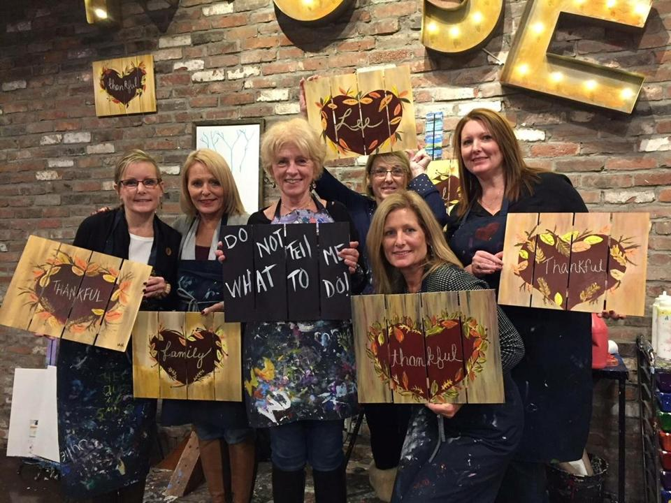 28zobeckham -- Beverly Beckham and her cousins exercising their painting skills at Muse Paintbar in Foxborough a few days before Thanksgiving 2017. (Handout)