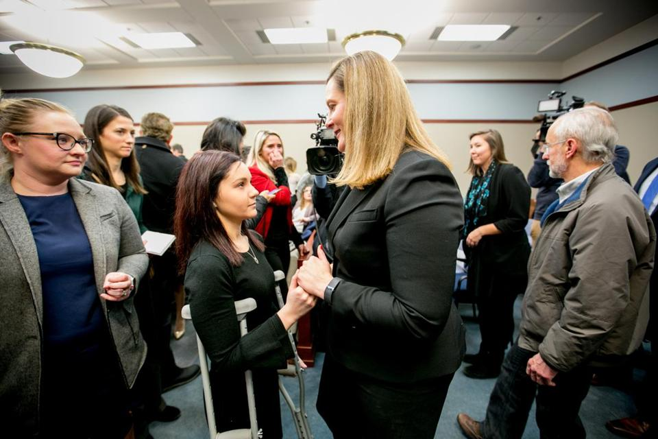Michigan Assistant Attorney General Angela Povilaitis (right) speaks to Kaylee Lorincz (left), a victim of Larry Nassar.