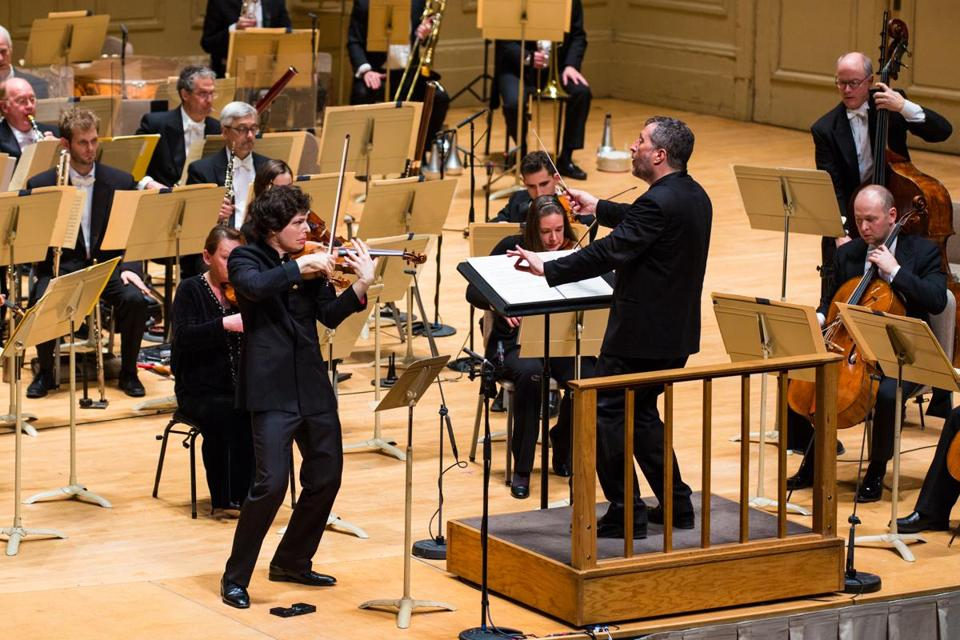 Thomas Adès leads violinist Augustin Hadelich and the Boston Symphony Orchestra at Symphony Hall Thursday.