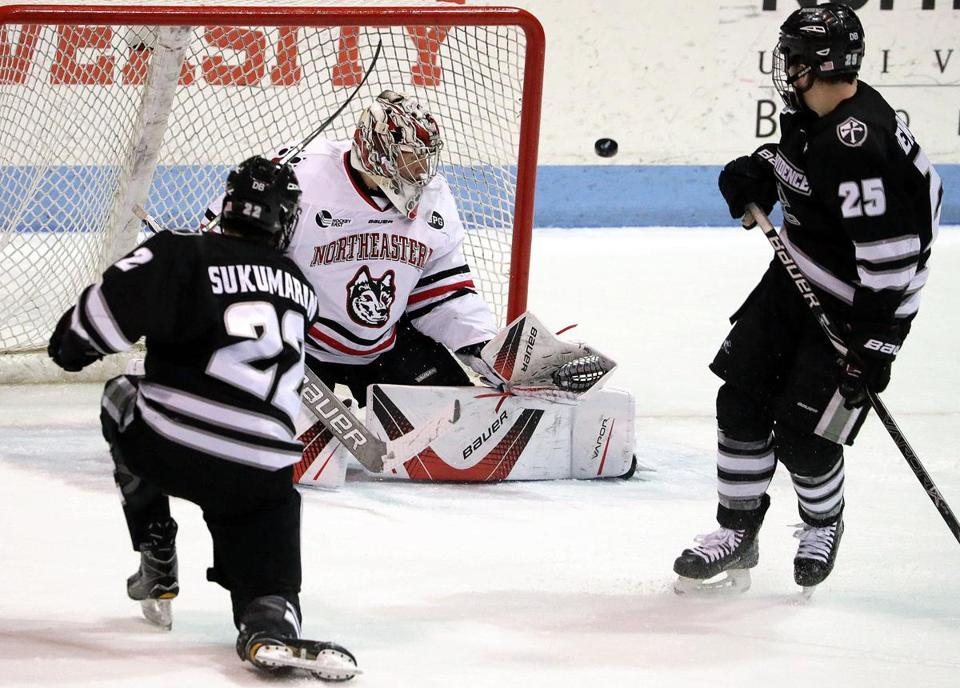 Boston, MA - 1/26/2018 - Northeastern Huskies goaltender Cayden Primeau (31) turns aside a shot by Providence Friars forward Vimal Sukumaran (22). Northeastern University hosts Providence College in men's hockey game at Matthews Arena. - (Barry Chin/Globe Staff), Section: Sports, Reporter: Globe Staff, Topic: 26PC-NU hockey, LOID: 8.4.791465057.