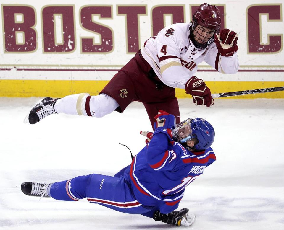 Chestnut Hill, MA - 1/27/2018 - (1st period) Boston College Eagles defenseman Michael Kim (4) levels Massachusetts-Lowell River Hawks forward Kenny Hausinger (10) with a open ice hit during the first period. Boston College hosts UMass-Lowell in Hockey East game at Conte Forum. - (Barry Chin/Globe Staff), Section: Sports, Reporter: Frank Dell'Apa, Topic: 28UMassLowell-BC, LOID: 8.4.745588610.