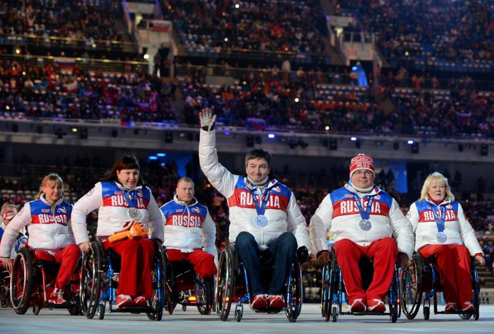 Russian team members attend the Closing Ceremony of the XI Paralympic Olympic games in Sochi in 2014.