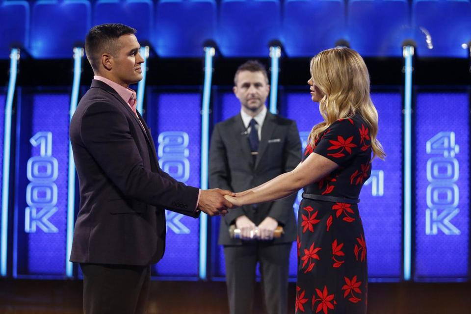 "Left: ""The Wall"" host Chris Hardwick looks on as contestant Nikko, a veteran with a Purple Heart, talks with his wife, Kassie."