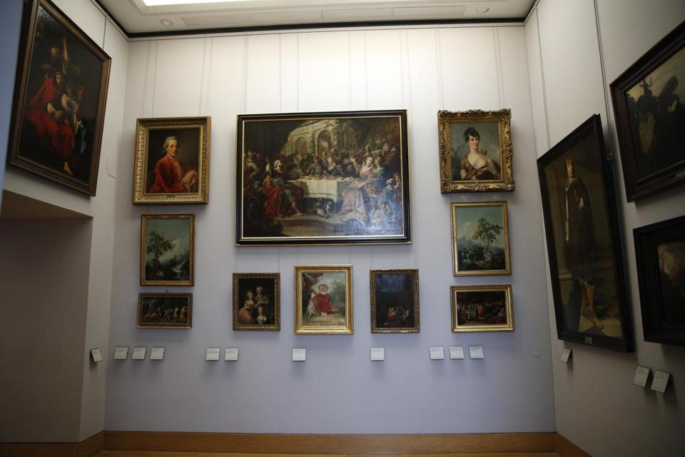 Paintings looted by Nazis during World War II are on display at the Louvre museum in Paris.