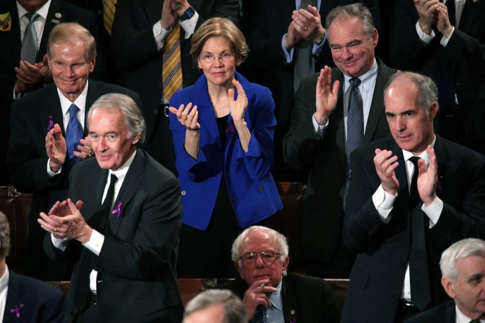 WASHINGTON, DC - JANUARY 30: U.S Sen. Elizabeth Warren (D-MA) (C) and Sen. Bernie Sanders (I-VT) watch during the State of the Union address in the chamber of the U.S. House of Representatives January 30, 2018 in Washington, DC. This is the first State of the Union address given by U.S. President Donald Trump and his second joint-session address to Congress. (Photo by Alex Wong/Getty Images)