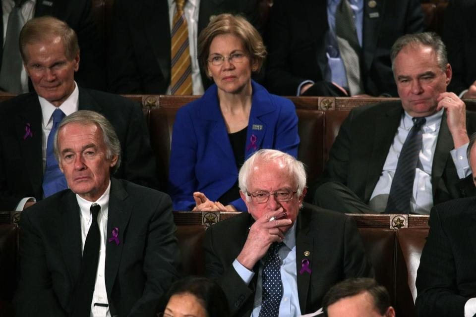 WASHINGTON, DC - JANUARY 30: U.S. Sen. Bernie Sanders (I-VT) (C) watches during the State of the Union address in the chamber of the U.S. House of Representatives January 30, 2018 in Washington, DC. This is the first State of the Union address given by U.S. President Donald Trump and his second joint-session address to Congress. (Photo by Alex Wong/Getty Images)