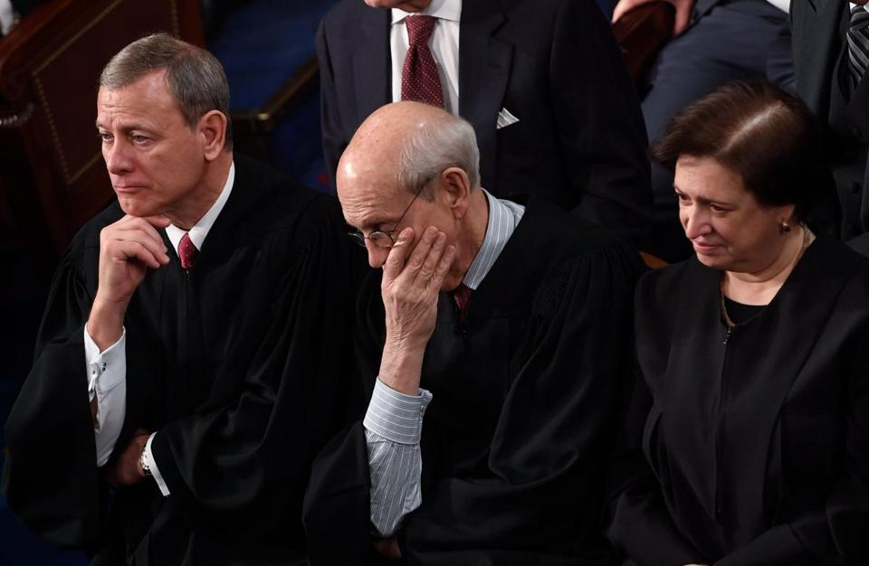 Breyer was seated between Supreme Court Justices John Roberts and Elena Kagan.