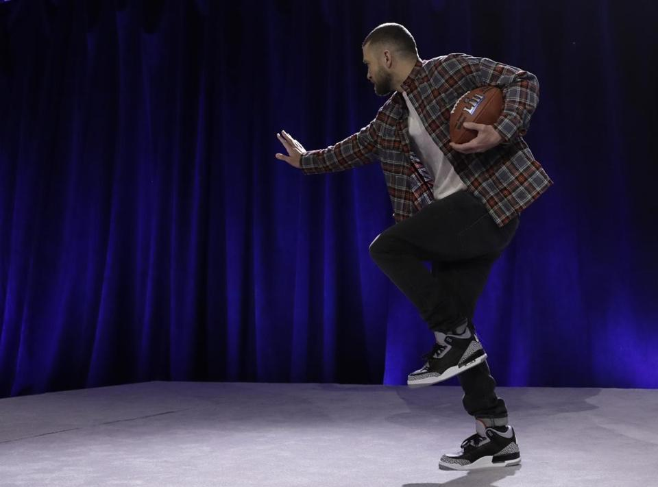 Justin Timberlake did a Heisman pose during a news conference.