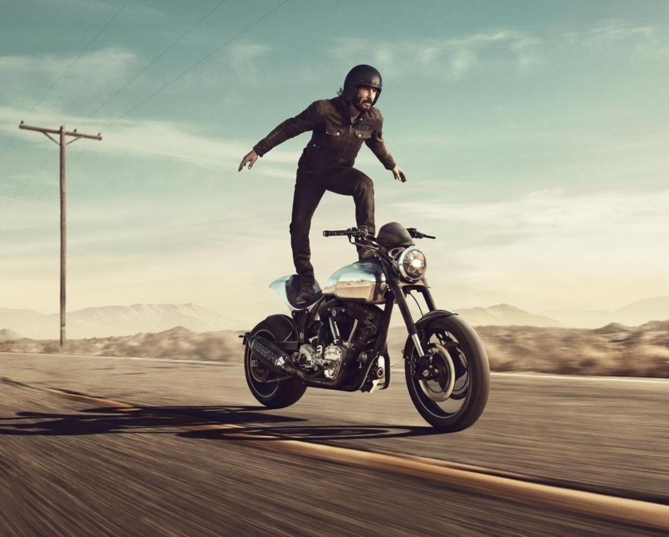 Keanu Reeves motorcycling in a Squarespace ad.