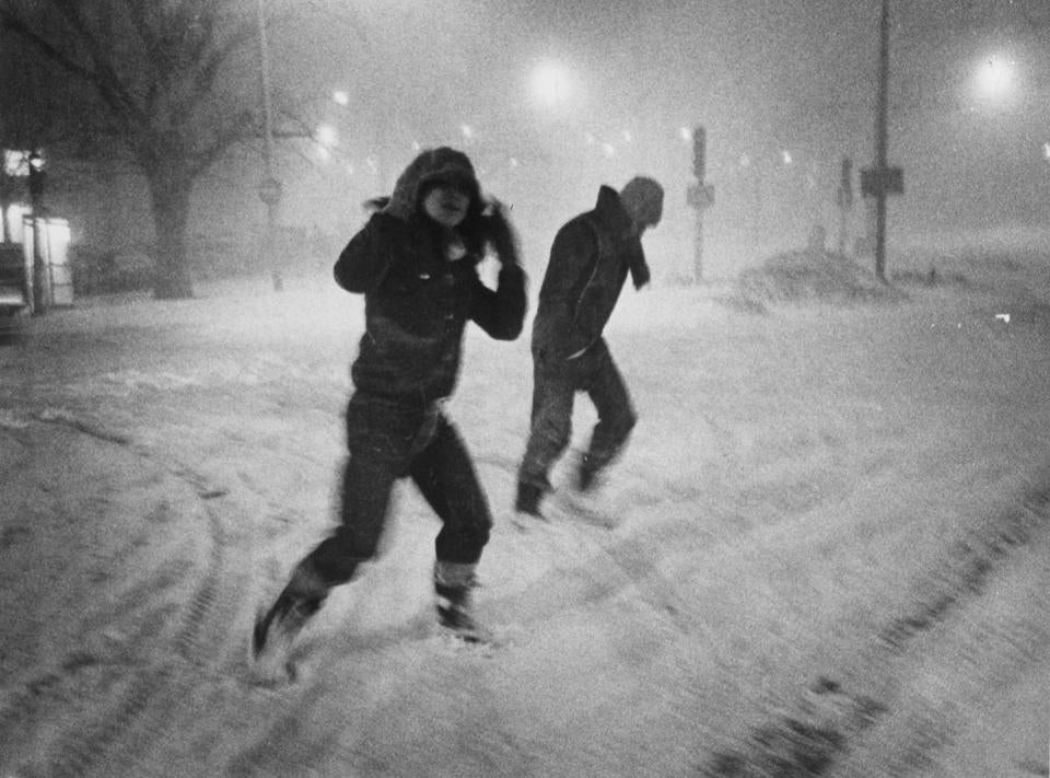 Pedestrians crossing Commonwealth Avenue during the storm.