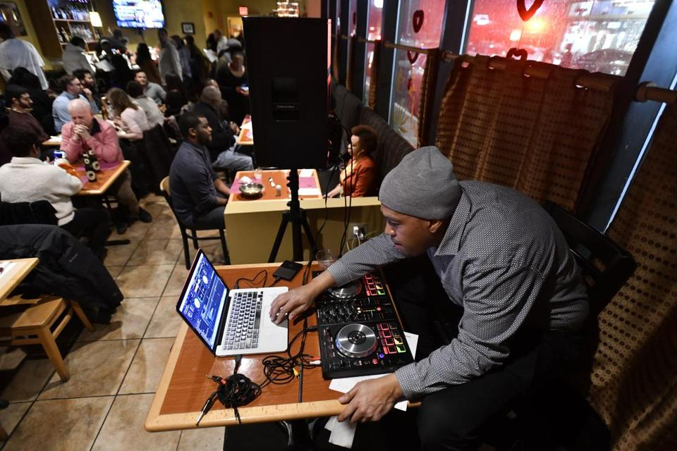 Justin Springer of Outside the Box DJs at Suya Joint during a Boston Black Restaurant Challenge event.