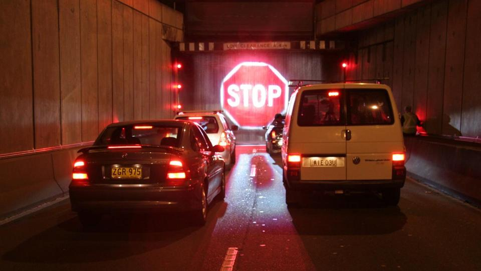 If a vehicle that's too tall to fit in the Sydney Harbour Tunnel gets too close to its entrance, a holographic-like image of a giant stop sign is projected onto a curtain of water.