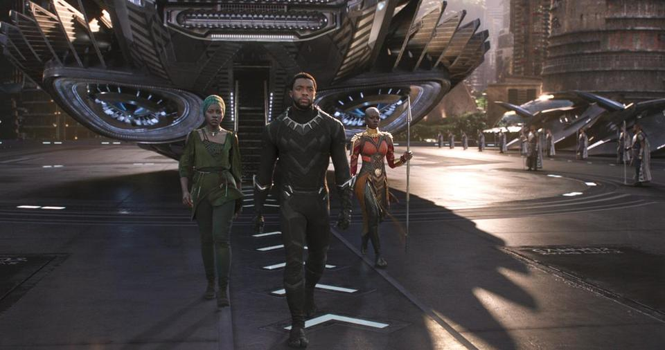 "L to R: Nakia (Lupita Nyong'o), T'Challa/Black Panther (Chadwick Boseman) and Okoye (Danai Gurira) in the 2018 film ""Black Panther,"" directed by Ryan Coogler."