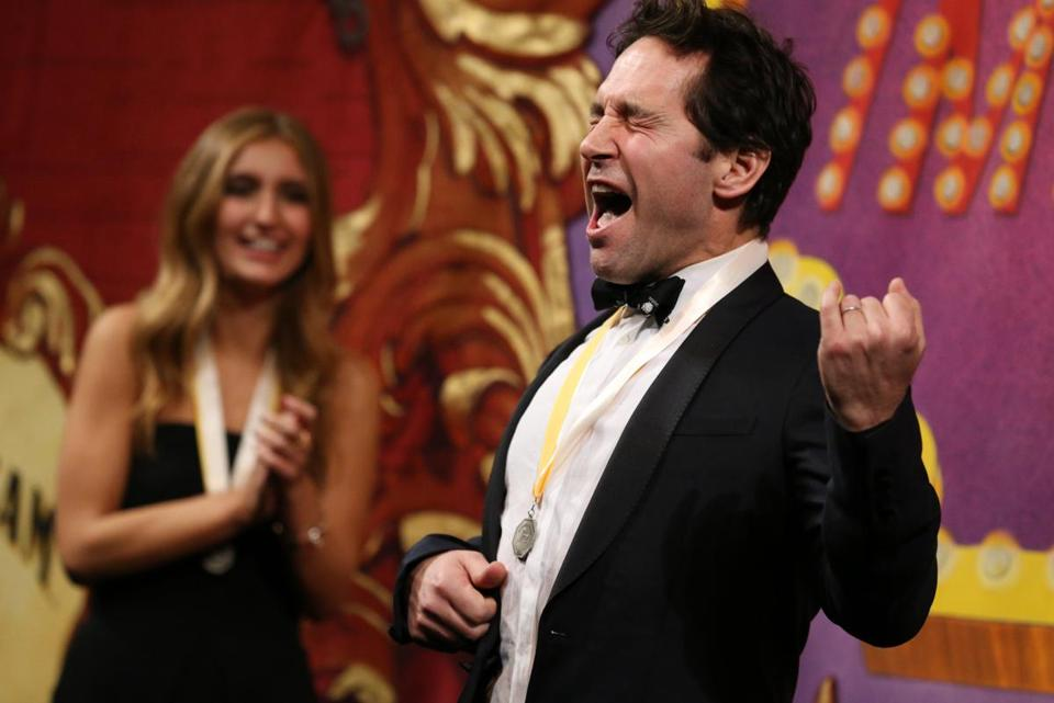 CAMBRIDGE, MA- February 02, 2018- : Roaster Hannah Needle enjoys watching actor and screenwriter Paul Rudd sing and play air guitar to Rush song Tom Sawyer during the Fifty Second Annual Hasty Pudding Theatricals Man of the Year Presentation at Farkas Hall in Cambridge, MA on February 02, 2018. Rudd was honored with the Hasty Pudding Theatricals' Man of the Year Award including a celebratory roast when he was presented with his Pudding Pot. (Craig F. Walker / Globe staff) section: Lifestyle reporter: