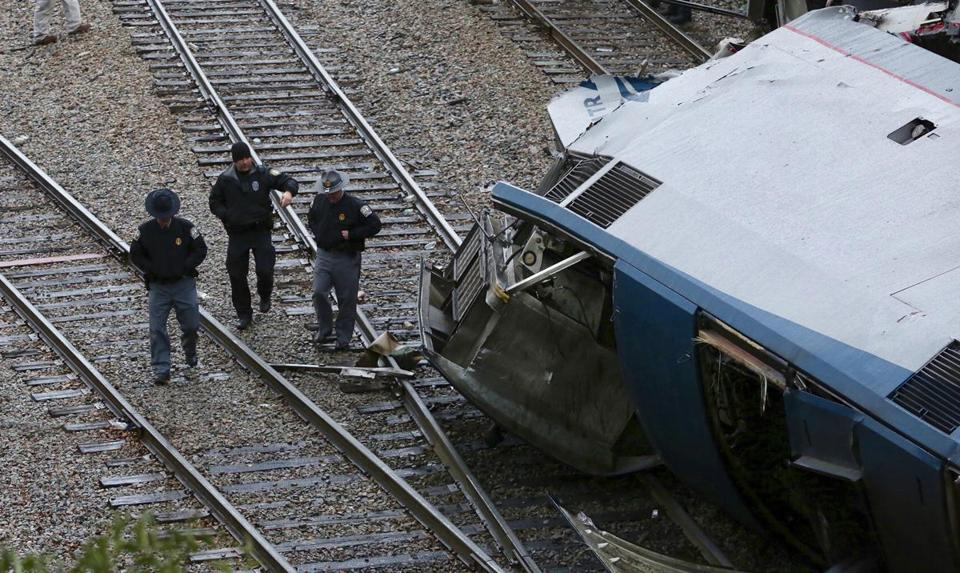 Authorities investigate the scene of a fatal Amtrak train crash in Cayce South Carolina Sunday Feb. 4 2018. At least two were killed and dozens injured