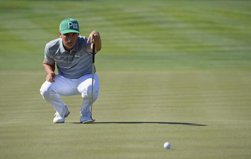 SCOTTSDALE, AZ - FEBRUARY 03: Rickie Fowler lines up a putt on the fifth hole during the third round of the Waste Management Phoenix Open at TPC Scottsdale on February 3, 2018 in Scottsdale, Arizona. (Photo by Robert Laberge/Getty Images)