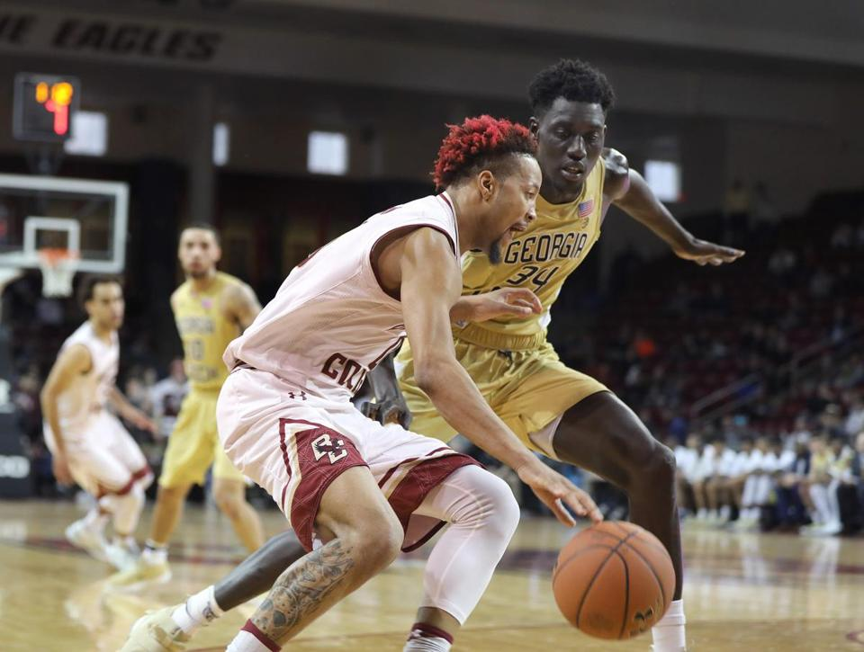 Chestnut Hill, MA - 2/4/2018 - Ky Bowman (cq) (0) charges past Abdoulaye Gueye (34) to the basket. BC beat Georgia Tech in overtime at Conte Forum (cq). Photo by Pat Greenhouse/Globe Staff Topic: BC-Georgia Tech Reporter: Frank Dell'Apa